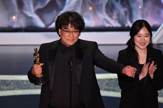 Bong Joon-ho, alongside translator Susan Choi, accepting the award for Best International Feature Film...
