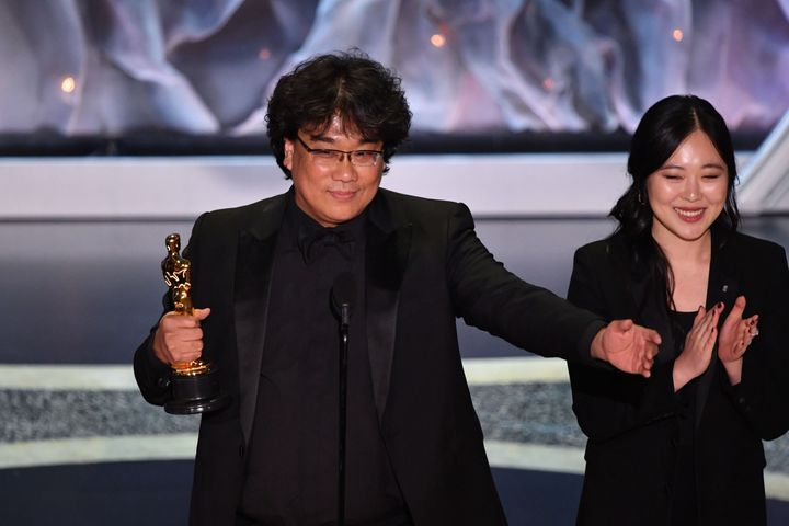 Bong Joon Ho, alongside translator Susan Choi, accepting the award for Best International Feature Film on Feb. 9, 2020.