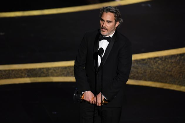 Joaquin Phoenix accepts the Actor In A Leading Role award for Joker onstage during the 92nd Annual Academy