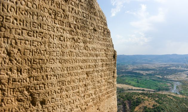 Ancient Greek writing chiselled on