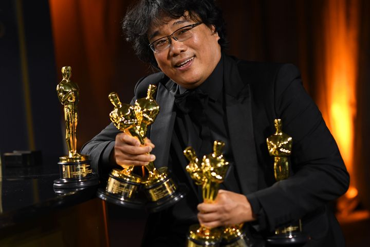 South Korean film director Bong Joon Ho poses with his engraved awards as he attends the 92nd Oscars Governors Ball.