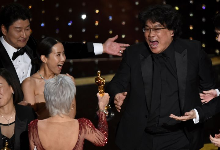 'Parasite' Director Bong Joon-ho accepting the Oscar for Best Picture from presenter Jane Fonda at the Dolby Theatre in Los Angeles.