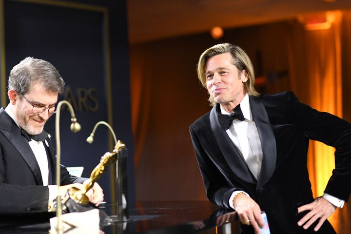 Brad Pitt waits for his award for Best Actor in a Supporting Role to be engraved as he attends the 92nd Oscars Governors Ball.