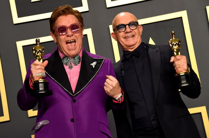 Elton John and Bernie Taupin with their Best Original Song Oscar for in the press room at the 92nd Academy Awards.
