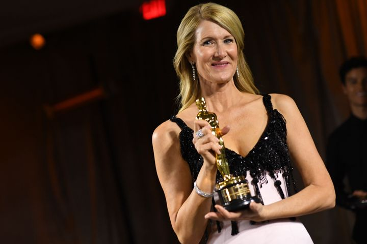 Laura Dern poses with her engraved award for Best Actress in a Supporting Role for Marriage Story.