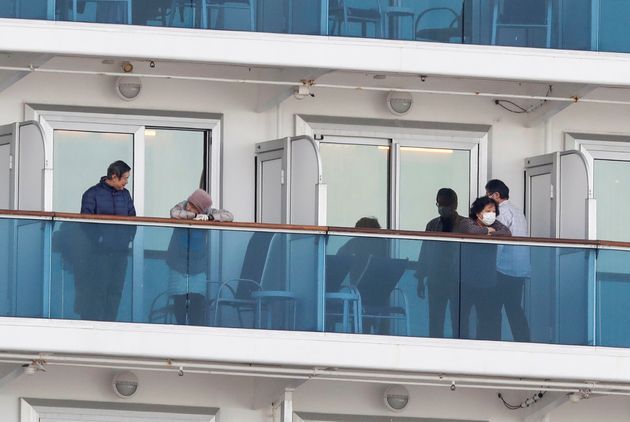 Passengers are seen in their cabins on the cruise ship Diamond Princess at Daikoku Pier Cruise Terminal...