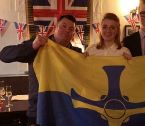 Dehenna Davison and Andrew Foster with a County Durham flag at a party celebrating Britain's exit from...
