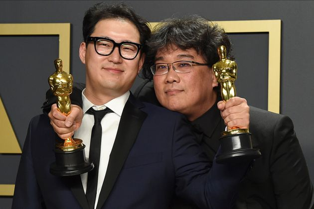 Han Jin Won, left, and Bong Joon Ho, winners of the award for best original screenplay for