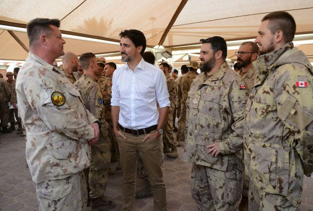 Prime Minister Justin Trudeau visits with Canadian troops at Camp Canada at Ali al Salem Air Base in...