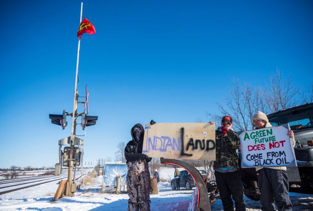 First Nations protesters block train tracks used by Via Rail on Saturday in Belleville, Ont., as part...