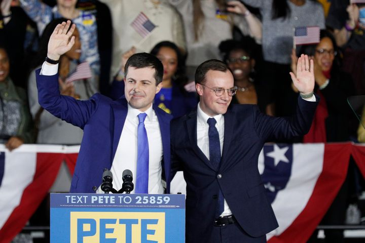 Democratic presidential candidate Pete Buttigieg, left, waves with his husband Chasten Buttigieg after declaring victory in Iowa on Feb. 3, despite the absence of complete results.