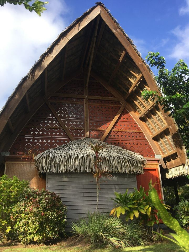 Our bungalow at Lapita Village in Huahine: Moonlight shone through the deltas etched into the wall to cast on our ceiling a p