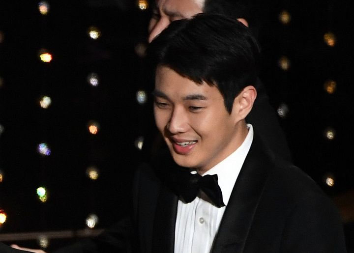 Choi Woo-shik accepts the Best Picture award for 'Parasite' onstage during the Academy Awards on Feb. 9, 2020 in Hollywood, Calif.