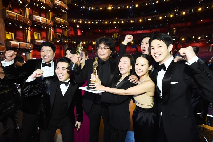 "The ""Parasite"" team pose with their newly won Oscars. Choi Woo-shik is on the far right."