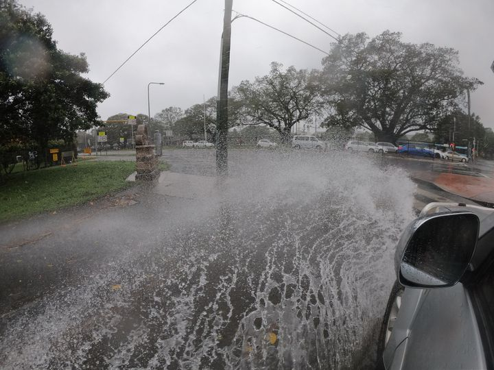 SYDNEY, AUSTRALIA - FEBRUARY 09: A car goes through flooding on Anzac Parade on February 09, 2020 in Sydney, Australia. The Bureau of Meteorology has forecast heavy rainfall across Sydney this weekend and issued a severe weather warning for dangerous winds, heavy rainfall and coastal erosion from abnormally high tides and damaging surf. (Photo by Mark Evans/Getty Images)