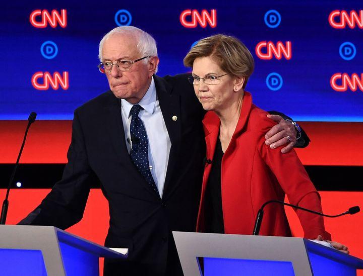Sen. Bernie Sanders (left) shares a moment with Sen. Elizabeth Warren before the Democratic presidential debate in Detroit in