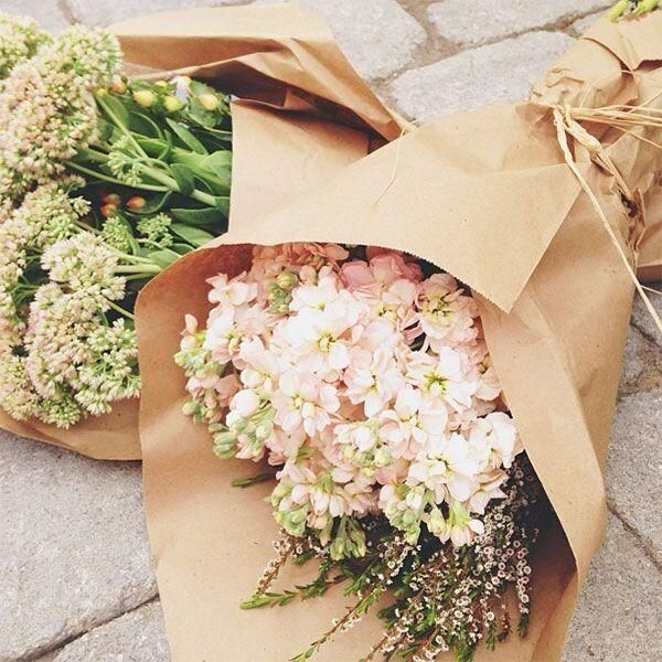 Flowers wrapped in paper, rather than plastic.