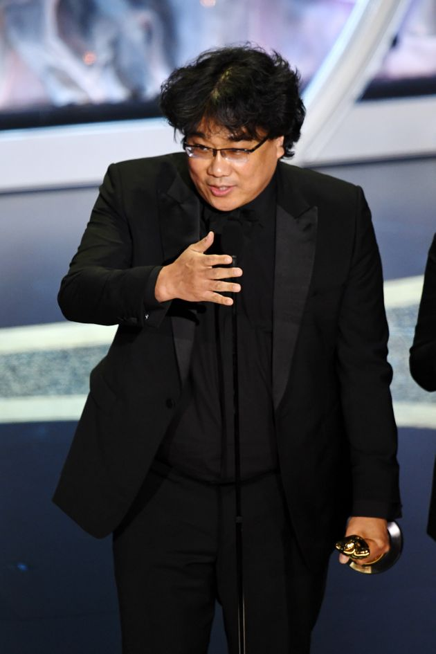 HOLLYWOOD, CALIFORNIA - FEBRUARY 09: Bong Joon-ho accepts the Writing - Original Screenplay - award for...