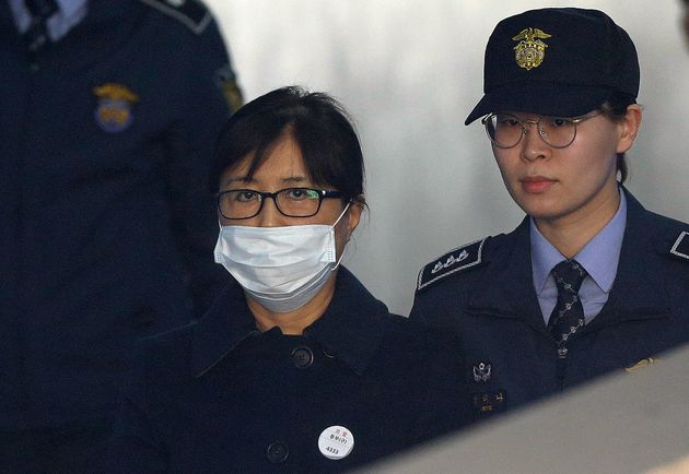 Choi Soon-sil, center, a confidante of former South Korean President Park Geun-hye, arrives at the Seoul...