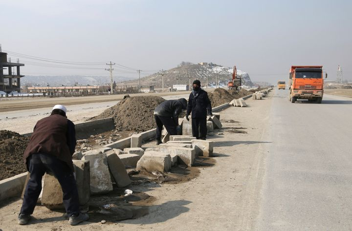 Afghan laborers work on a bridge project funded by the government, in Kabul, Afghanistan, on Feb. 10, 2020.