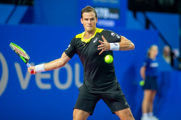 Canadian tennis player Vasek Pospisil competes against David Goffin of Belgium at the Open Sud de France...