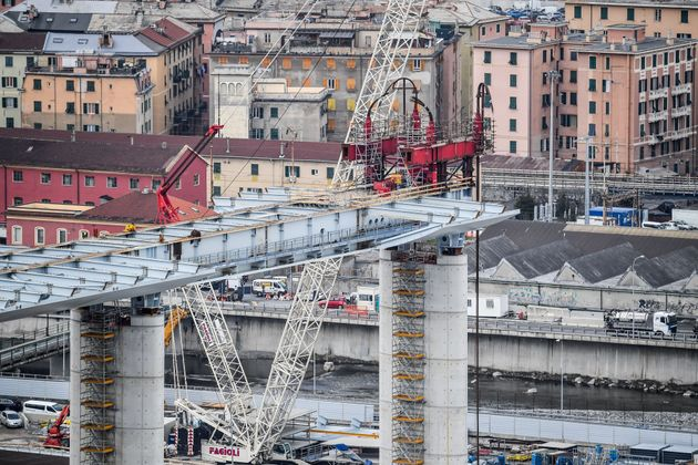 A view of Genoa's new bridge as sections are lifted into position, on February 10, 2020 in Genoa, replacing...