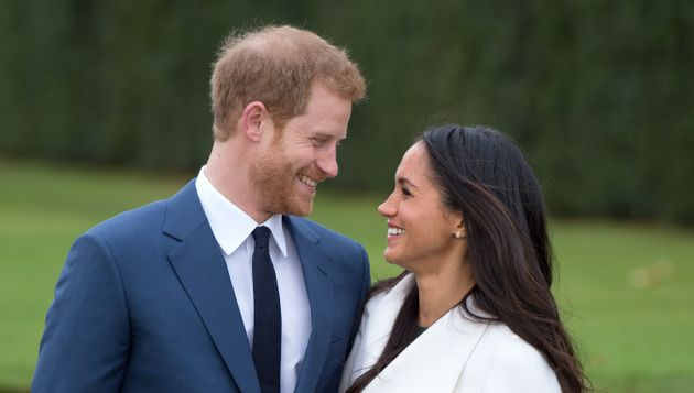 Harry and Meghan attend a photocall in the Sunken Gardens at Kensington Palace following the announcement...