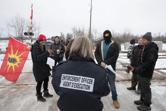 An Enforcement Officer reads the Injunction to members of the Tyendinaga Mohawk Territory in Tyendinaga...