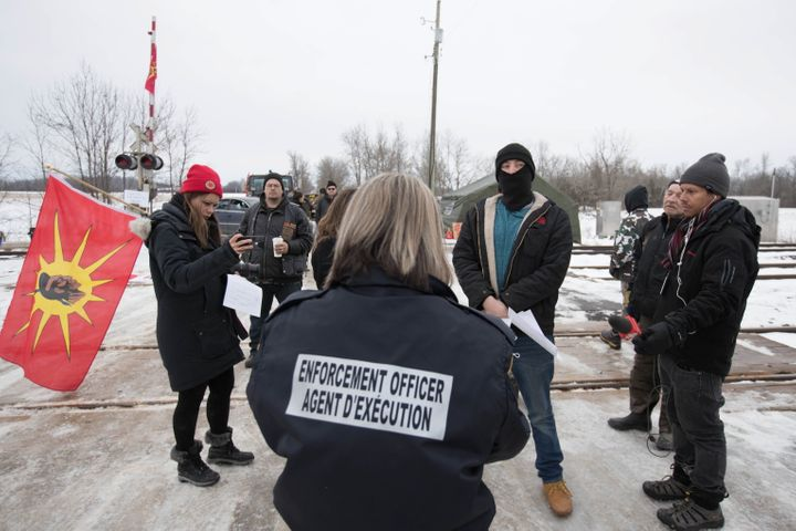 An Enforcement Officer reads the Injunction to members of the Tyendinaga Mohawk Territory in Tyendinaga Mohawk Territory, near Belleville, Ont., on Feb. 11, 2020.