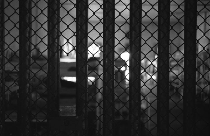 View through prison bars of dormitory bunks at Mississippi State Penitentiary (or Parchman Farm), Mississippi, 1964. Since it