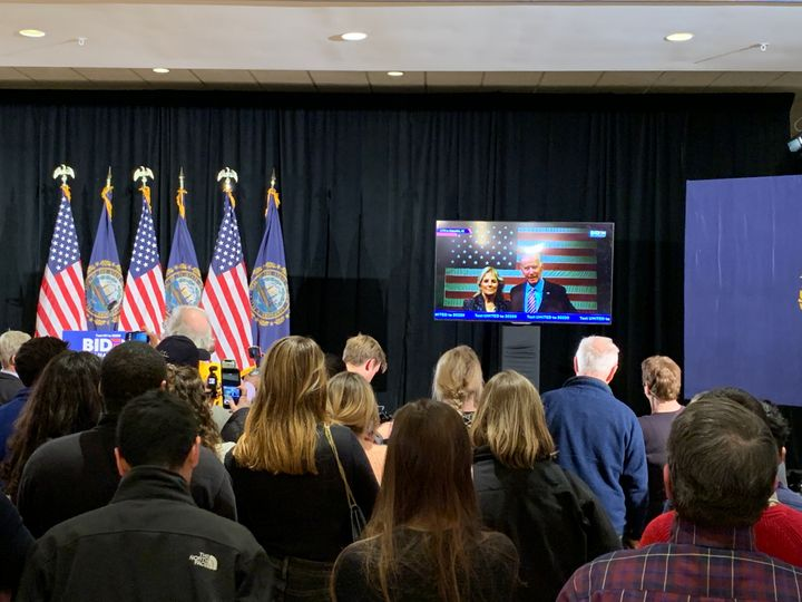Joe Biden supporters listen to the former vice president speak via live stream at his New Hampshire primary party on Tuesday