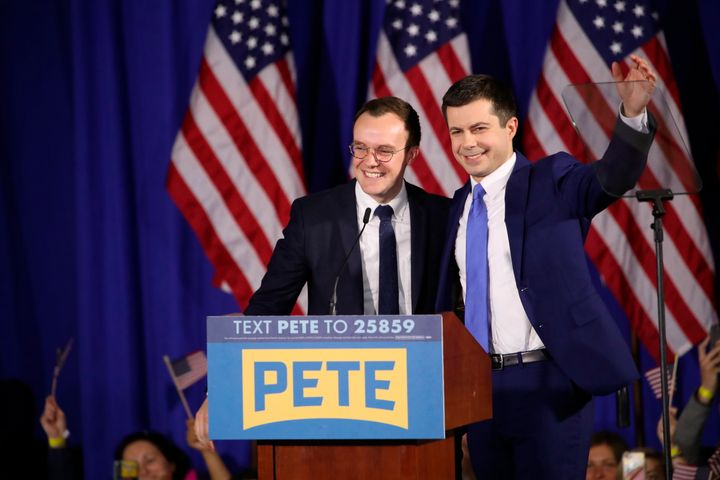 Former South Bend, Indiana Mayor Pete Buttigieg, right, celebrates with his husband, Chasten, at an election night party in N