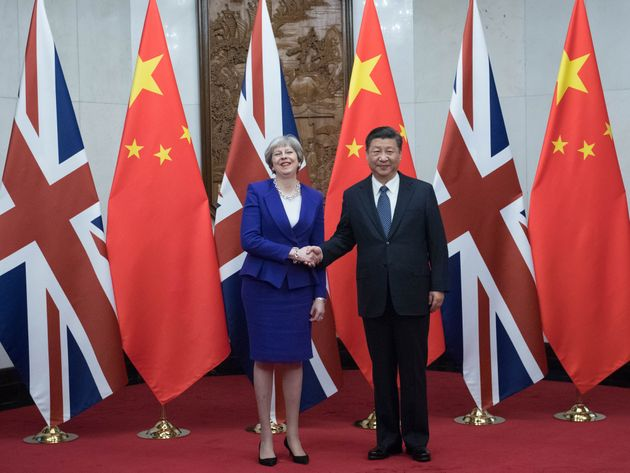 In Pictures: Theresa May Awakens The Dragon In