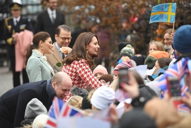 High-Fives For William And Kate As They Meet Schoolchildren In