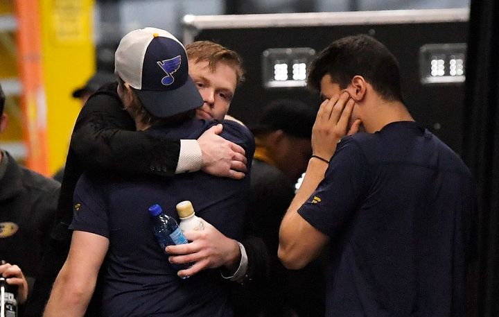 Anaheim Ducks left wing Max Jones, second from right, greets two members of the St. Louis Blues after Blues defenseman Jay Bo