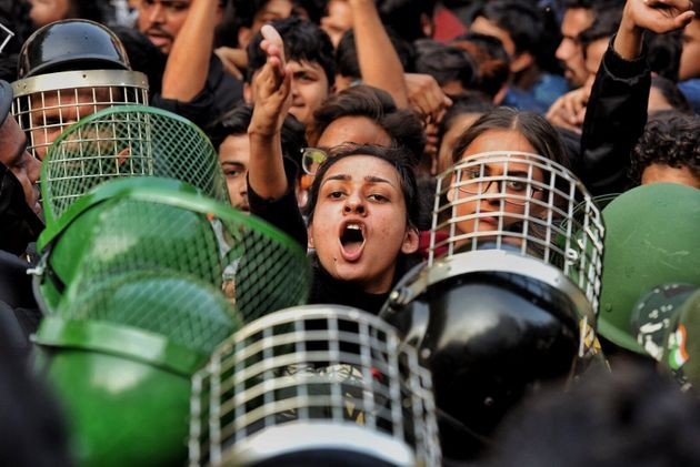 Delhi Police personnel and demonstrators during the march to Parliament near Jamia Millia Islamia, on...