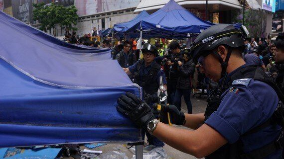 In Pictures: Police Clear Final Umbrella Movement Occupy Outpost in Hong
