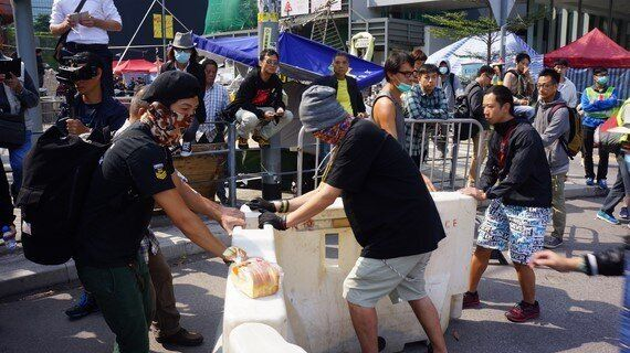 In Pictures: Hong Kong Democracy Camp Shrinks as Barricades