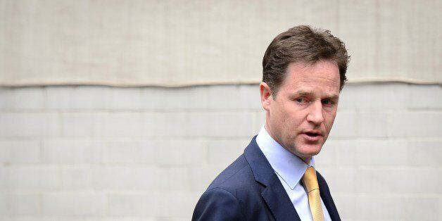 Liberal Democrat party leader Nick Clegg leaves the party headquarters in Westminster, central London,...
