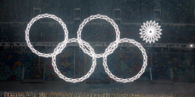 Performers sing as the Olympic rings are presented during the Opening Ceremony of the Sochi Winter Olympics...