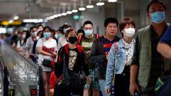 China asegura que los contagios por coronavirus bajan en el epicentro de la