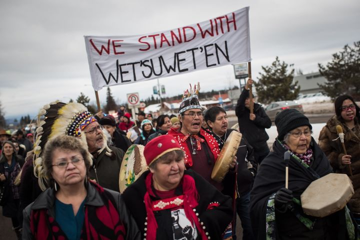 Hereditary Chief Ronnie West from the Lake Babine First Nation sings and beats a drum during a solidarity march in Smithers, B.C., on Jan. 16, 2019.