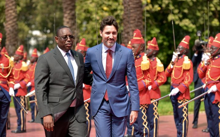 Senegal's President Macky Sall walks alongside Prime Minister Justin Trudeau, upon arrival at the Presidential Palace in Dakar, Senegal, on  Feb. 12, 2020.