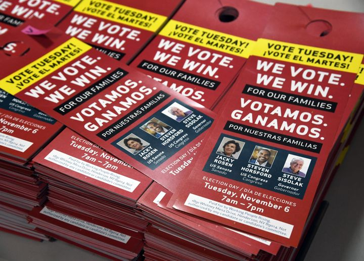 Political door hangers are stacked before a rally with union members at the Culinary Workers Union Hall Local 226 on November