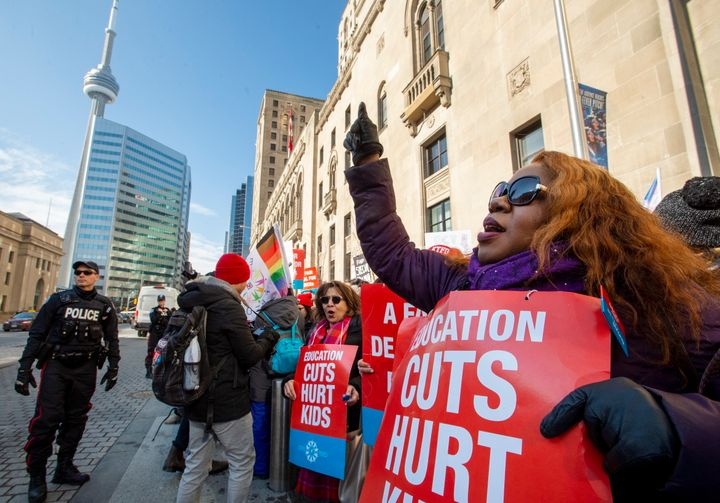 Striking school teachers protest outside a speech by Ontario Education Minister Stephen Lecce in Toronto on Feb. 12, 2020.