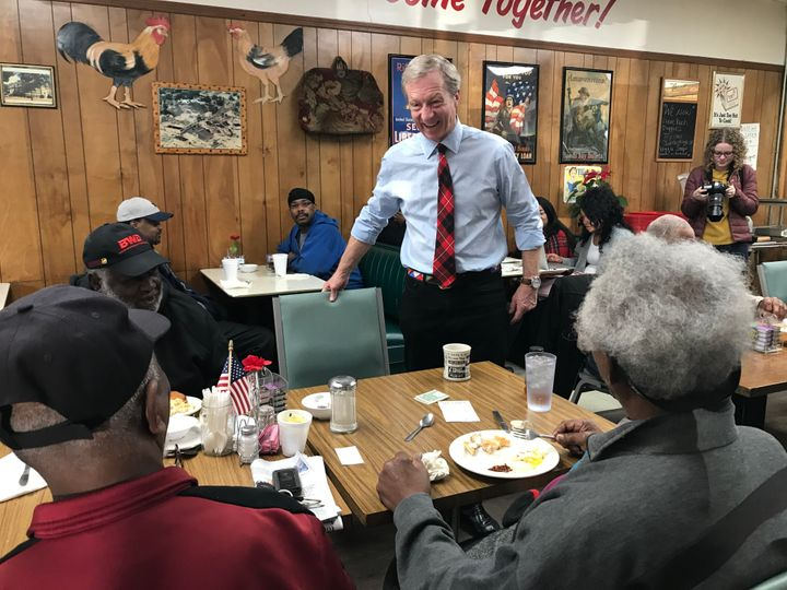 Presidential Candidate Tom Steyer greets residents at Gene's Restaurant in Chester, South Carolina, over breakfast.