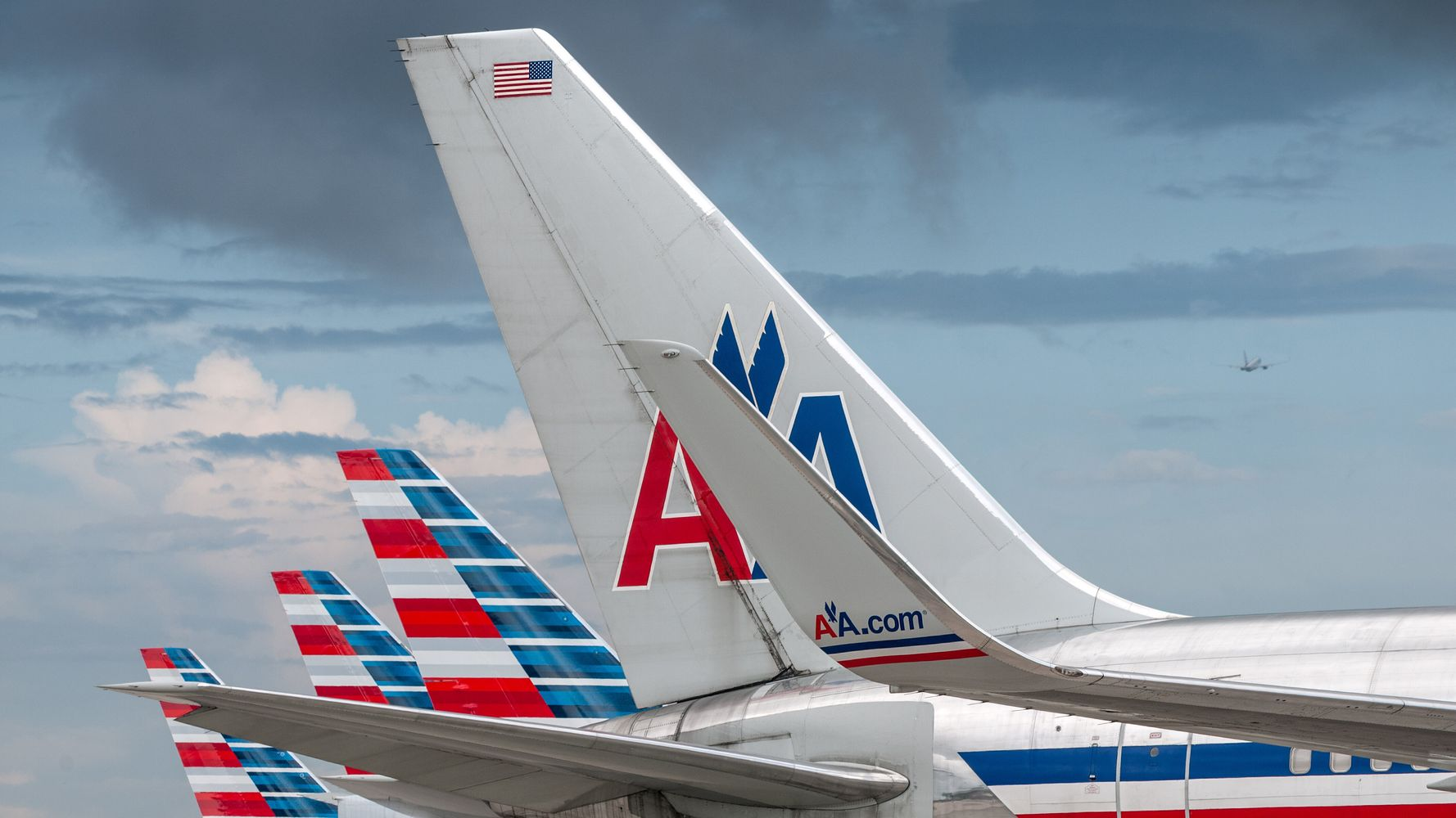 Woman Calls Out American Airlines Over Passenger Punching Her Reclined Seat