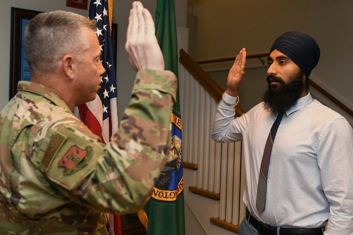 Gurchetan Singh recites the oath of enlistment on Sept. 27, 2019, at Camp Murray in Washington state. Singh is the first Sikh