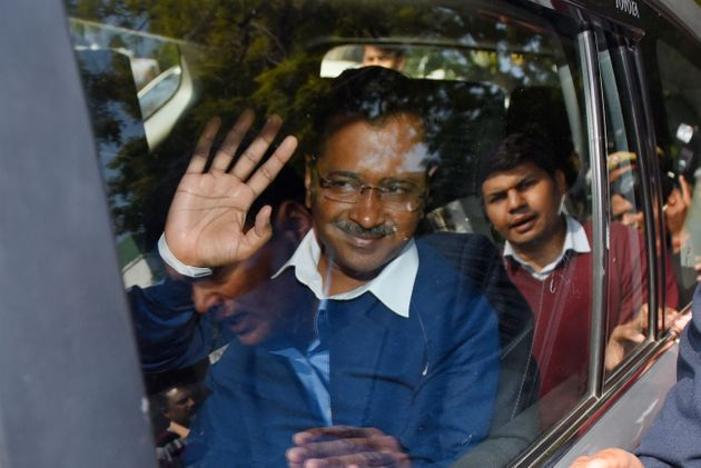 Chief Minister designate and AAP Chief Arvind Kejriwal arrives for a meeting with Lieutenant Governor...