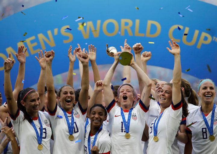 FILE - In this July 7, 2019, file photo, United States' Megan Rapinoe lifts up a trophy after winning the Women's World Cup f